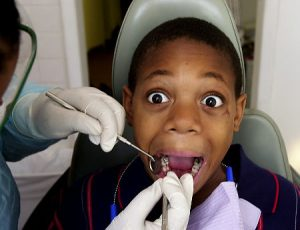 Kids from the area have their teeth checked out and cleaned during Free Dental Clinic DAy at 360 W 125th St in Manhattan Sherard Weathers has second thoughts when the work begins   Original Filename: 6d800k0n.JPG