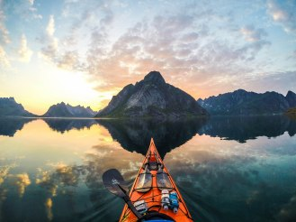 PIC FROM MERCURY PRESS/CATERS NEWS.(PICTURED: THE VIEW FROM TOMASZ FURMANEKS KAYAK AS HE PADDLES THOUGH NORWAYS RUGGED LANDSCAPE)These are the photographs of stunning natural beauty as seen through the lens of a kayakers GoPro camera. Intrepid Tomasz Furmanek spends his spare time away from the Institute of Marine Research gliding atop the waters in some Norways most idyllic beauty spots. For 10 years, Tomasz, a software developer, has visited many of the fjords in western Norway, inland lakes and the areas around Lofoten Islands in Northern Norway...SEE MERCURY COPY